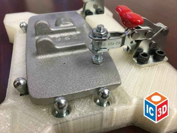A 3D printed fixture with toggle clamps and insert nuts holding a cast piece ready to be machined